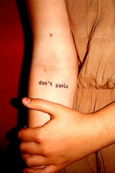 """This is my first tattoo but for sure not the last one. I got it in ""Top Hat Tattoo"" in Chicago. Done by Crystal Martinez. She is a great tattoo artist as well as a great person. I got ""don't panic"" on my forearm for two reasons. First - I have a panic disorder and I needed some kind of remainder to stay calm. Second - The first Coldplay song I ever heard was called ""don't panic"" and because of it I fell in love with a Coldplay band."" -- I love it. One of my favourite Coldplay songs too."