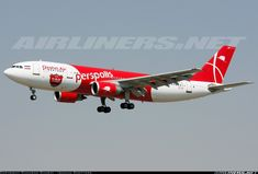 Qeshm Airlines (IR) Airbus A300B4-605R aircraft, painted in '' F.C Persepolis'' special colors, on short final to Iran, Tehran Mehrabad  Int'l Airport. 08/09/2013. (F.C. Persepolis=a Persian Gulf Pro League professional football club in Tehran).