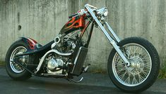 Honda Shadow vt600 hardtail custom with downtube/backbone stretch and flame paintjob by Good Co. Customs | front right