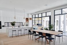 Project designed and completed by Construct Melbourne. Photography by Simon Shiff. Styling by Norsu Interiors. Ethnicraft Dining Table and Chairs, Henry Hirst Raw Oak Floorboards, Windows from Design Window Solutions in Matte Black.