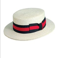 La Scala Classic Straw Boater Hat Classic straw boater hat, featuring a two tone striped grosgrain band with bow trim. Twill sweatband. 2 in brim. Size range: Regular. Size: Small. Color: Bleach La Scala Accessories Hats