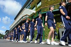 Ball boys and girls line up in preparation for day six. - Neil Tingle/AELTC