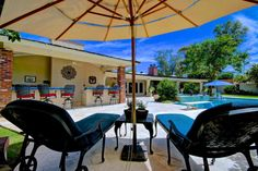 This is an awesome back yard oasis features a pool, spa, BBQ grill