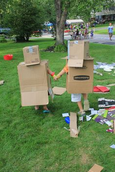 """I guess we should go and show everyone"" said the big robot. ""Okay"" said the little robot.  The cutest pair of robots I have ever helped to dress. - Pop-Up Adventure Play"