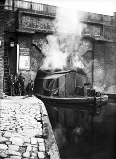 Western entrance of Islington Tunnel with steam powered tug & boatmen waiting for their craft to emerge c1905