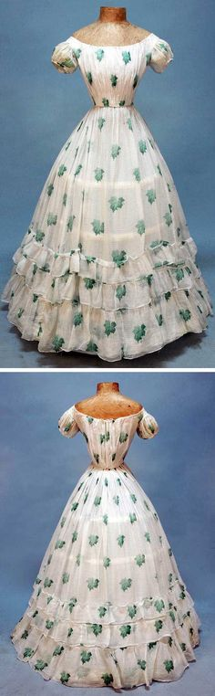 Young lady's summer party dress, 1860s. White cotton voile with horizontal pinstripe weave printed with shaded green oak leaves, having drawstring boatneck, short puffed sleeve and three graduated skirt ruffles, self piping, cotton bodice lining, back hooks & eyes. Whitaker Auctions