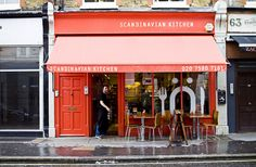 Scandinavian Kitchen | London. Colors, wood chairs/tables, building/door/awning style, simple type signage/awning, and simple, oversized icon window decal.