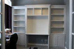 bookshelves with desk built in