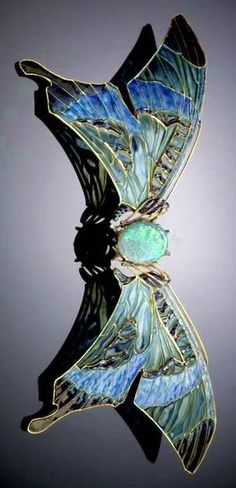 Lalique 1903-04 Butterfly Buckle: gold/plique-à-jour enamel/opal/ sapphire. The wings on either side of the central opal body are delicately hinged so that they move w/the movement of the wearer
