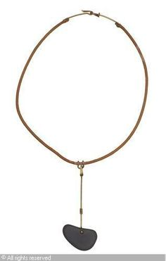 A leather and brass necklace sold by Bukowskis, Stockholm, on Friday, April 27, 2012
