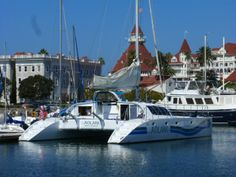 Aolani Catamaran Sailing docked at Seaforth Boat Rentals Coronado Hotel del Coronado in the backdrop  http://www.aolani.cc