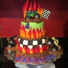 Monster Jam cake - Grave  Digger - white cake filled with buttercream, covered in marshmallow fondant with marshmallow and buttercream fondant and buttercream icing details - made by me at Sugared Dreams Cakes & Bakes #monsterjamcake  #gravediggercake