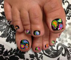 Funky Toes. Black toe nails with multi color paisley designs. Bold and trendy. I can't wait to try this out !