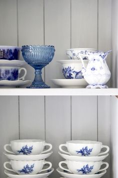 This is what open shelves would look like in my kitchen (kind of) with blue and white and blue and gray dishes against the white.  I like it.