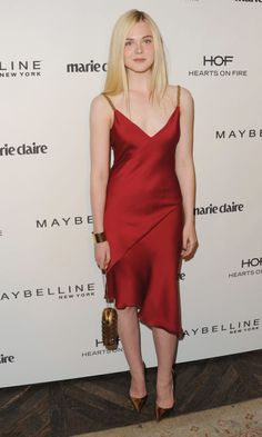 Elle Fanning in a red dress at an event in West Hollywood. See all of the actress's best looks.