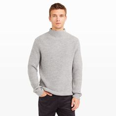 "Clean and classic, our ribbed mock-neck sweater adds an effortless feel to wool trousers and elevates blue jeans and joggers. Merino wool Straight fit 31"" center back length, based on a size M Allover ribbing; mock neck Dry clean Imported"