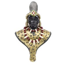 "London jeweller Theo Fennel interprets a portrait of  Shaka Zulu.  ""Eight craftsmen a piece worked on each brooch, carving mammoth  bone and moonstone, setting emeralds, rubies and diamonds and engraving golden costumes."""