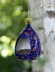pottery bird feeder with drainage holes and hanging cord.