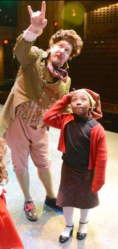 "J. Scott Gallo gives a tour of the Players Guild Theater set of Charles Dickens's ""A Christmas Carol"" to Canton Montessori school student Bithiah Jackson Tuesday afternoon. Gallo is dressed as Mr. Fezziwig."