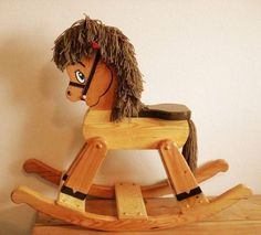 "This is Rockie, a wonderfully hand-crafted rocking horse which your kids can enjoy for many years, and generations to come. The horse body is made of pine 1 1/2 to 3 thick, over all 27 high, 36 long anti-tip rockers, 12 wide at rocker, with the seat 16"" from the rocker rung. It weighs between 17-20 pounds. We patterned Rockie after a horse made for our daughter 20 years ago which has withstood countless hours of play and is still rocking in great condition today. Recommended for children…"