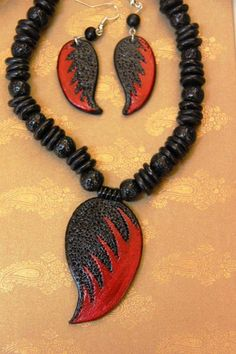 Handmade. Cold porcelain polymer clay air dry clay. Necklace earrings red black