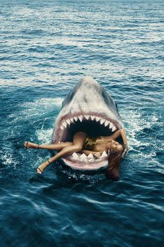 Rihanna swims with sharks for BAZAAR's March cover shoot. See the full fashion editorial here: