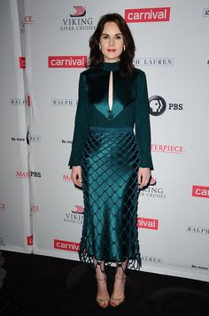 Who: Michelle Dockery When: August 01, 2015 Why: I can't get used to seeing Michelle Dockery out of her period garb in the same way I'll never get used to Matthew Crowley being gone, but this sophisticated mermaid look helps. This rich, emerald-hued Dion Lee ensemble compliments her skin tone and is reminiscent of her Downton wardrobe in the best way possible.   - ELLE.com