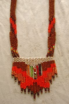 """""""Fire"""" - Early work from 1990's - Adjustable length, stair-step design with straps.  SOLD.  Woven by Terri Scache Harris, theravenscache.shutterfly.com   Hand woven, handwoven, weaving, weave, needleweaving, pin weaving, woven necklace, fashion necklace, wearable art, fiber art."""