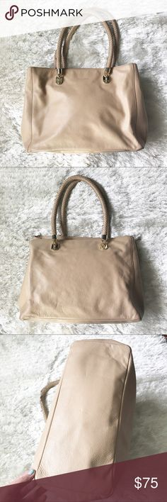 COLE HAAN Shoulder Bag with Braided Straps Gently used Cole Haan purse. Softly pebbled leather in a light tan leather. Only visible wear is a dent on bottom of purse. This has braided shoulder straps. Would make a great every day, classic pocket book. Color is between a tan and cream leather. Pretty blue lining. Cole Haan Bags Shoulder Bags