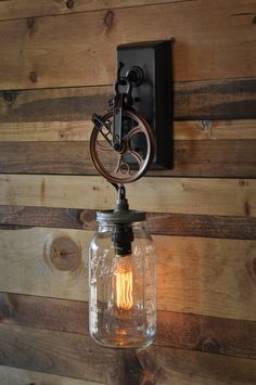Mason Jar chic - Cool industrial mason jar wall sconce with a pulley wheel and mason jar.  The old fashioned edison bulb seals the deal.
