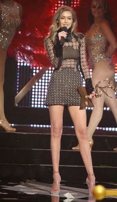 While accepting the Guys Choice Award for 'New Girlfriend,' the 21-year-old model showed some skin in a black mini dress with circular cutouts all over.