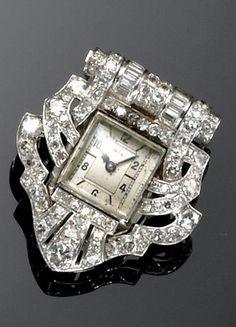An Art Deco gold and diamond watch-clip, circa 1930. Signed Vetta #ArtDeco #watch #clip