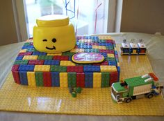 Lego Cake - Lego birthday party...like the lego paper wrapped board the cake is sitting on!!!