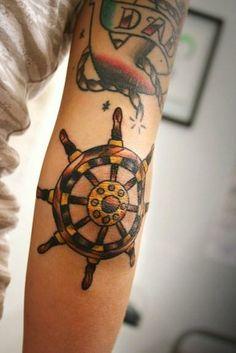 ships wheel just below elbow tattoo | ShipHelm