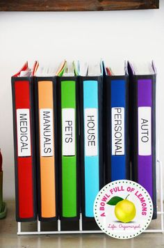 Use a kitchen baking sheet organizer to hold binders filled with important information. | 37 Clever Ways To Keep Your Whole Family Organized