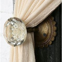 Curtain holders-use antique doorknobs. these can be found at flea markets, hobby lobby, garage sales