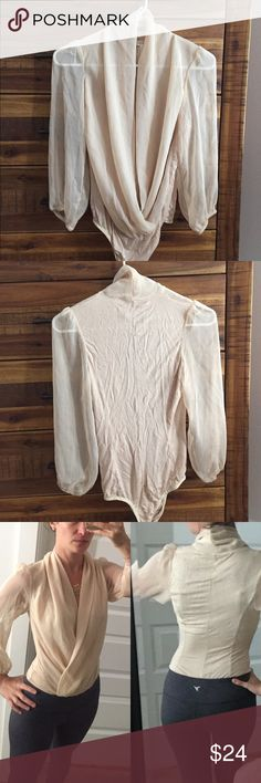 🆕Necessary Clothing Sz S nude body suit worn once Necessary Clothing Sz S nude body suit - worn once. This is one of the brands that Necessary Clothing sells - purchased at the store. The front hangs like a v neck and is double layer of a sheer material. The sleeves are 3/4 length and sheer. The back is a soft, stretchy cotton and is not sheer. Sexy and looks great with skinny jeans or under a blazer. I'm normally XS 💃🏻 Necessary Clothing Tops