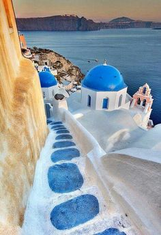 Walk the white-washed steps of Santorini, Greece.