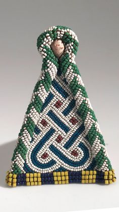 Africa   Cache -sexe / modesty apron panel or belt pendant from the Kuba people of Lukengu, Congo   Raffia plant fiber, glass beads and cowrie shell   ca. 1910 or earlier