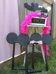 Minnie Mouse photo booth props at a Minnie Mouse party! See more party planning at kitscheventstyling.com