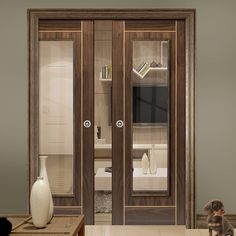 Double Pocket Valcor Walnut sliding door system in three size widths with Clear Glass. #moderndoors #glazeddoors #internalpocketdoors