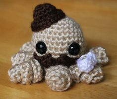 Hipster amigurumi Octopi with bowler hat and tea cup crocheted by dsgnGrl on Etsy.