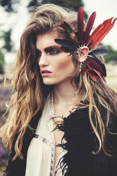earpiece by Bibi van der Velden.. i wish this model wasnt so disgusted looking, ruining the feather mojo lady! :(