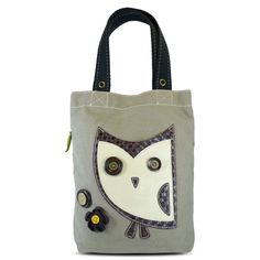 """Chala Simple Tote - HooHoo Owl. •Playful owl in the front is a convenient pocket! •Character includes detailed stitching and metal button eyes •Fabricated flower and an etched wooden button •Magnetic snap closure •Side zippered pocket with leaf zipper charm •Patterned fabric lining with slide pockets & zippered pocket, Materials used: Canvas cotton & Textured faux leather,Approx. Measurements: 13.5"""" x 3.5"""" x 15"""", Handles drop: 9"""",Shop online at www.shopthehandbagstore.com"""