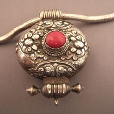 Silver, brass, coral, Tibet Description This is a typical tibetan g'au worn for… Tribal Jewelry, Indian Jewelry, Buddhist Symbols, Fashion Accessories, Fashion Jewelry, Prayer Box, Evil Spirits, African Beads, Ancient Jewelry
