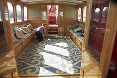 Labour of love: A rug bearing the Queen¿s cipher is laid. It was hand-woven in Nepal and features 240,000 knots