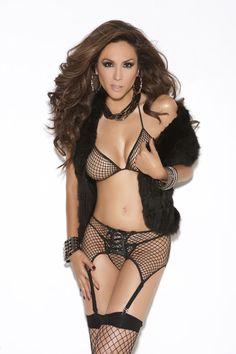 Seductive lingerie set. Features bra top, garter belt and g-string.