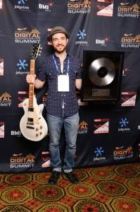 Air Traffic controller the winner of AOV, showing off his plaque and @Gibson Guitar, #NMS2013