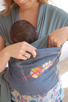 seriously - pockets are a must with any baby carrier!  Check out how, with a wee bit of crafting, you can add one to your Moby or Boba wrap.