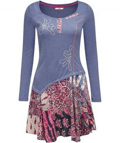"""This super flattering tunic is the perfect addition to any spring wardrobe. In jersey fabric with embroidered details, the pretty mixed print hem adds a fresh touch. Approx Length: 94cm (at longest point) Our model is: 5'7"""""""